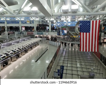 NEW YORK, NY, USA - SEPTEMBER 6, 2018: Morning hour at JFK Terminal 1 with empty checkpoint lanes and floors, John F. Kennedy International Airport.