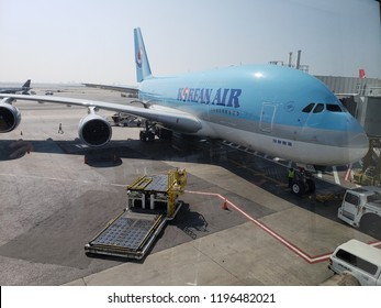 NEW YORK, NY, USA - SEPTEMBER 6, 2018: Airbus A380 of Korean Air parked at Terminal 1 in John F. Kennedy International Airport;  New Your cityscape in distant background