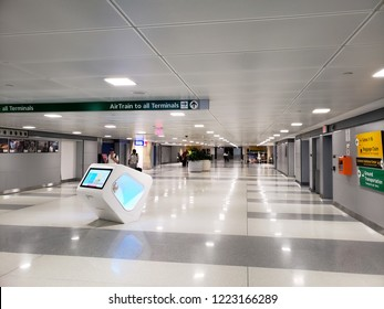NEW YORK, NY, USA - SEPTEMBER 6, 2018: Pedestrian tunnel with signs to directing to Airtrain and all airport terminals in JFK, John F. Kennedy International Airport.