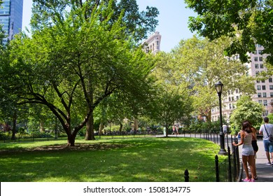 New York, NY, USA - September 18, 2019:Madison Square Park is a public park maintained by an active neighborhood support group and is a popular relaxation area for both adults and children.