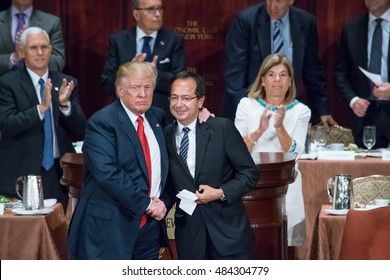 NEW YORK, NY, USA - SEPTEMBER 15, 2016: Donald Trump embraces John Paulson and shake hands at the conclusion of Mr. Trump's presentation to the Economic Club of New York at the Waldorf Astoria.