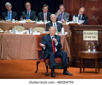 NEW YORK, NY, USA - SEPTEMBER 15, 2016: Donald Trump answers questions at the Economic Club of New York at the Waldorf Astoria. Vice Presidential candidate Mike Pence is seated behind Trump.