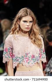 New York, NY, USA - September 7, 2017: A model walks runway for the Tadashi Shoji Spring/Summer 2018 runway show during New York Fashion Week at Skylight Clarkson Sq., Manhattan