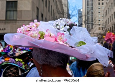 New York, NY, USA: A woman wearing a pink and white flowered Easter bonnet at the annual Fifth Avenue Easter Parade.