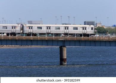 NEW YORK, NY, USA-MAY 27: Subway train run overpass over sea near Broad Channel station, May 27, 2013
