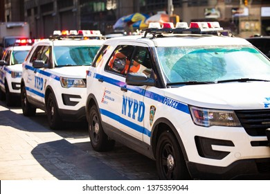 New York NYPD Police car with sirens at day on street
