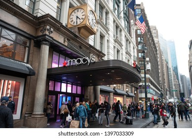 New York, NY/United States- 04/23/2019: Passerby walk past the exterior of Macy's flagship store at Herald Square