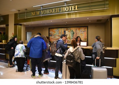 New York, NY/United States- 04/23/2019: A group of tourists wait in line to check into the New Yorker hotel.