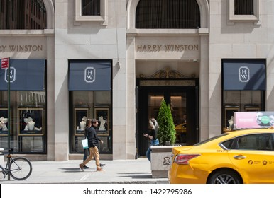 New York, NY/United States- 04/28/2019: People walk past the Harry Winston flagship store on Fifth Avenue