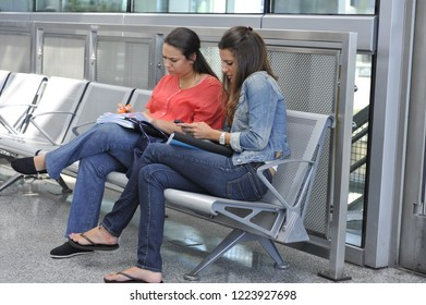 New York, NY/United States- 09/10/2017: A teenage girl and her mother wait patiently at JFK airport after their flight is delayed.