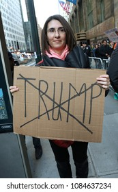 New York, NY/USA- April 14, 2016: A woman holds an anti-Trump sign. Hundreds of demonstrators protested presidential candidate Donald Trump near Penn Station.