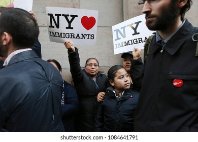 "New York, NY/USA- April 14, 2016: Hispanics hold signs that say ""NY Loves Immigrants"" during a rally. Hundreds of demonstrators protested presidential candidate Donald Trump near Penn Station."