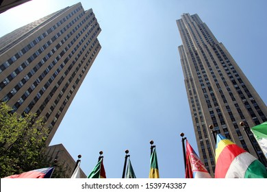 New York, NY/USA - April 19, 2012: 1 Rockefeller Plaza, the original Time & Life Building, and 30 Rockefeller Plaza, with flags of various countries