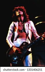 New York, NY/USA - June 14, 1977: Guitarist Jimmy Page of Led Zeppelin performs at Madison Square Garden on their 1977 North American tour.