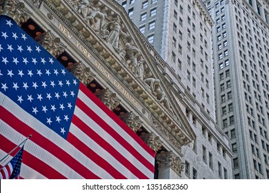 New York, NY/USA - May 1, 2006: Angled view of the New York Stock Exchange building with large American flag covering the facade. EDITORIAL USE ONLY