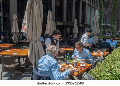 New York NY/USA May 7, 2018 Diners enjoy the warm spring day as they dine al fresco at Del Frisco's restaurant in Midtown Manhattan