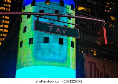 New York, NY/USA- October 15, 2015: Brilliant blue/green advertisement on Times Square building is backdrop to 7th Ave street sign. In Midtown Manhattan, 7th Ave is also known as Fashion Ave.