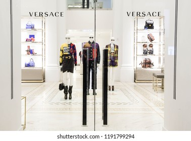 New York, N.Y./USA - Sept. 29, 2018: Mannequins wearing the latest Versace fashions in a Versace store in Manhattan after hours.