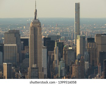 New York, NY/USA-6/5/15: The Empire State Building, center, with 432 Park, nearing completion, in the background at right.