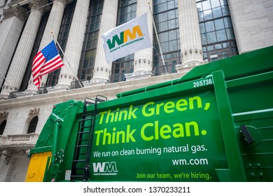 New York NY/USA-April 21, 2017 Waste Management (WM) vehicles are parked in front of the New York Stock Exchange.