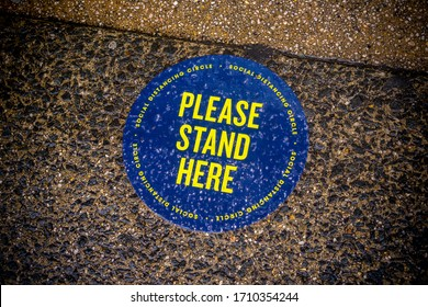 New York NY/USA-April 21, 2020 Sidewalk signage outside a store in New York posts directs customers to observe social distancing