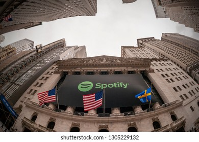 New York NY/USA-April 3, 2018 The facade of the New York Stock Exchange decorated in honor of the debut of trading for the music streaming service Spotify.