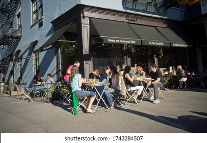 New York NY/USA-April 30, 2011 Diners eat outside at a sidewalk cafe of the Le Pain Quotidien in the New York neighborhood of Tribeca