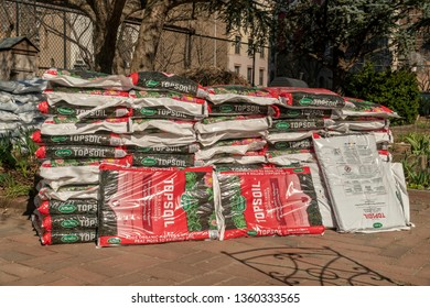 New York NY/USA-April 4, 2019 Bags of topsoil waiting to be distributed to members' plots in a community garden in New York