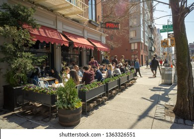 New York NY/USA-April 6, 2019 Al fresco dining is de rigueur in the East Village in New York during a warm spring day