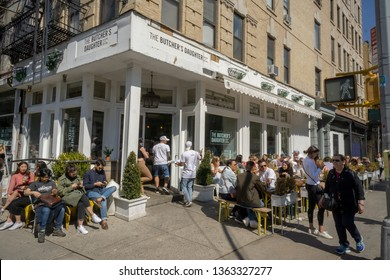 New York NY/USA-April 6, 2019 Al fresco dining is de rigueur at the Butcher's Daughter restaurant in New York