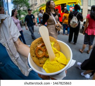New York NY/USA-August 1, 2019 Ice cream and mustard lovers enjoy scoops of FrenchÕs Mustard Ice Cream made with Coolhaus ice cream and FrenchÕs Yellow Mustard.