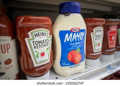 New York NY/USA-August 10, 2015 Bottles of Kraft Heinz mayonnaise and ketchup on a supermarket shelf in New York