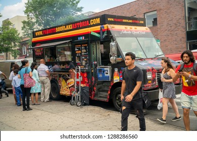 New York NY/USA-August 12, 2018 Loyal customers line up at Frankys Souvlaki Astoria food truck in the Astoria neighborhood of Queens in New York