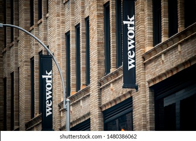 New York NY/USA-August 16, 2019 A sign announces the location of a a WeWork co-working space location in Chelsea in New York