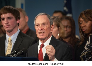 New York NY/USA-December 17, 2012 New York Mayor Mike Bloomberg stands with survivors and relatives of victims of gun violence in the Blue Room in City Hall
