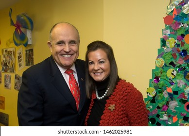 New York NY/USA-December 23, 2009 Former New York Mayor Rudy Giuliani, joined by his wife Judy Giuliani, (formerly Nathan)  makes his 16th annual visit to Hale House