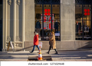 New York NY/USA/-December 29, 2018 Shoppers pass a Sweaty Betty athleisure retail store advertising its sales in New York
