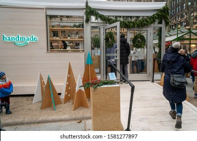 New York NY/USA-December 6, 2019 Visitors to Bryant Park in New York outside the Amazon Handmade Holiday Market pop-up store selling a curated selection of artisan made merchandise