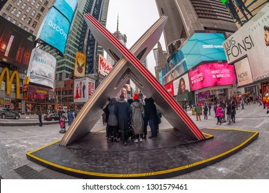 "New York NY/USA-February 1, 2019 Tourists and the media crowd ""X"", the winner of the Times Square Valentine Heart Design in Times Square in New York"