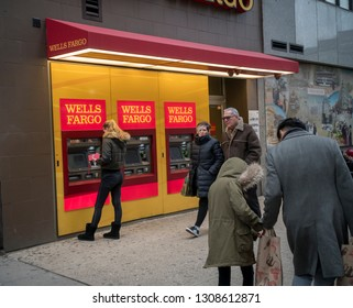 New York NY/USA-February 17, 2018  A woman uses a free standing Wells Fargo ATM  in New York