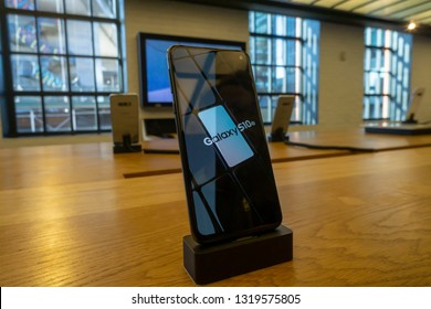 New York NY/USA-February 21, 2019 Visitors to the Samsung 837 showroom in the Meatpacking District in New York admire the Samsung Galaxy S10 smartphone
