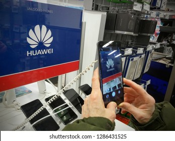 New York NY/USA-February 8, 2018  A consumer tries out an Huawei brand, Chinese manufactured, smartphone in a Best Buy store in New York