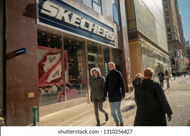New York NY/USA-February 9, 2019 Pedestrians walk past a Skechers store in New York