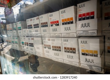 New York NY/USA-January 13, 2019 A selection of the popular Juul brand vaping supplies on display in the window of a vaping store in New York