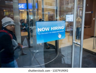 New York NY/USA-January 8, 2015 A sign in the window of a JPMorgan bank branch in New York advises potential job applicants that they are hiring