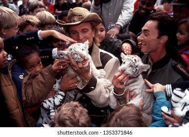 "New York NY/USA-July 1, 1996 Las Vegas performers Siegfried Fischbacher, left, and Roy Horn, known as ""Siegfried and Roy"" appear in a rare New York City event with two of their white tiger cubs"