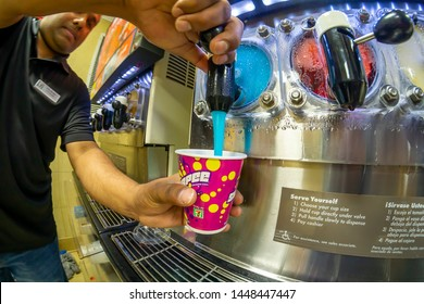 New York NY/USA-July 11, 2019 A worker fills a Slurpee in a 7-Eleven store in New York on the self-proclaimed holiday Free Slurpee Day!