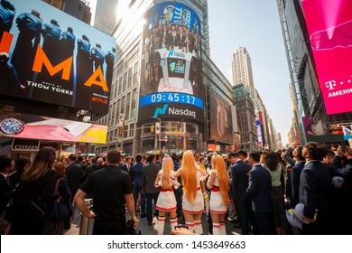 New York NY/USA-July 17, 2019 Employees with their families and friends gather at the Nasdaq in Times Square decorated for the debut of the DouYu International Holdings initial public offering