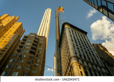 "New York NY/USA-July 25, 2019 The Extell development, Central Park Tower, right, with other towers, rises above surrounding buildings on West 57th Street, colloquially known as ""Billionaire's Row"""