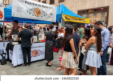 New York NY/USA-July 30, 2019 Tourists and office workers line up at Pasteis De Nata in The Outpost of the Queens Night Market, located in Rockefeller Plaza